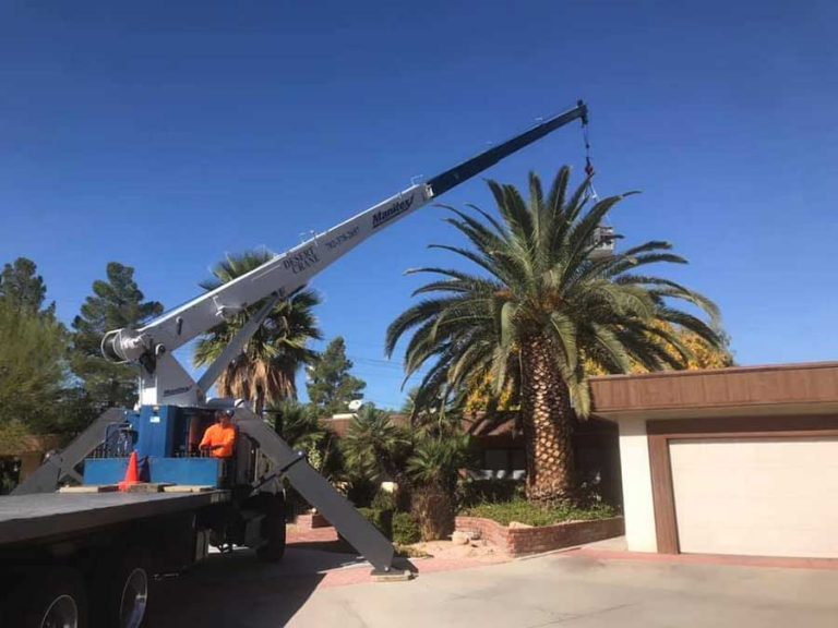 Crain lifting an air system above a home residence 2