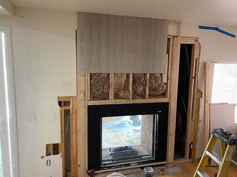 Evolve services working on a fireplace