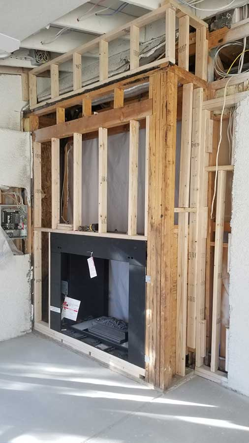 Evolve services working on a custom fireplace