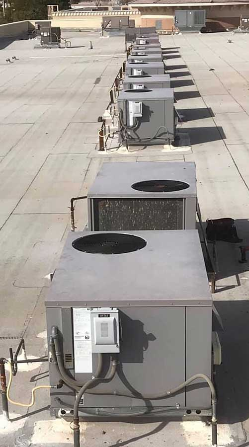 10 Air systems on a roof in a row.