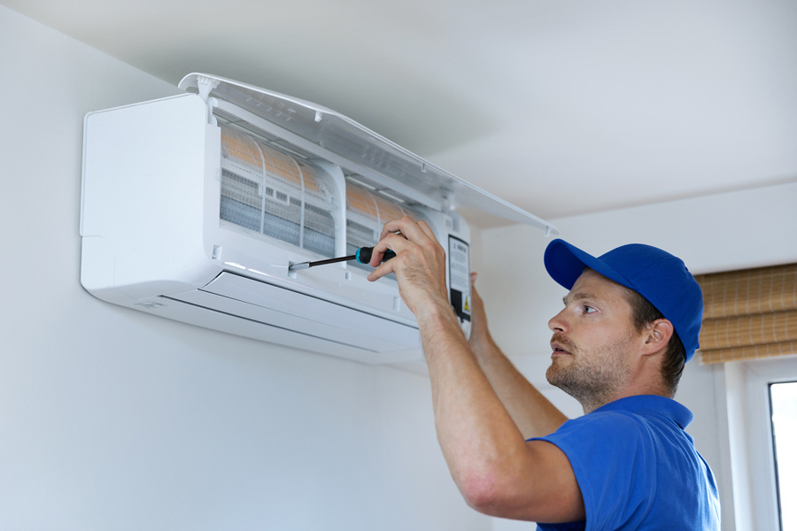 A HVAC Technician fixing an air conditioner