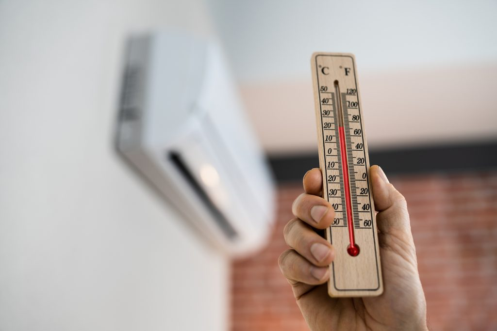 Holding Thermometer near AC
